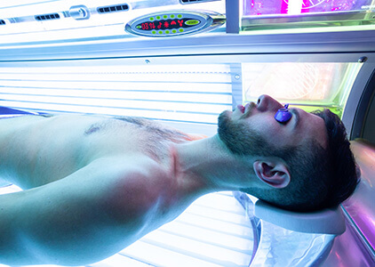 Man Using Indoor Tanning Bed