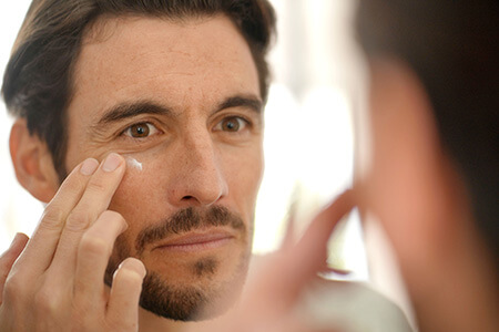 Man Applying Moisturizer to Face