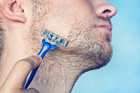 Man Shaving with Disposable Razor